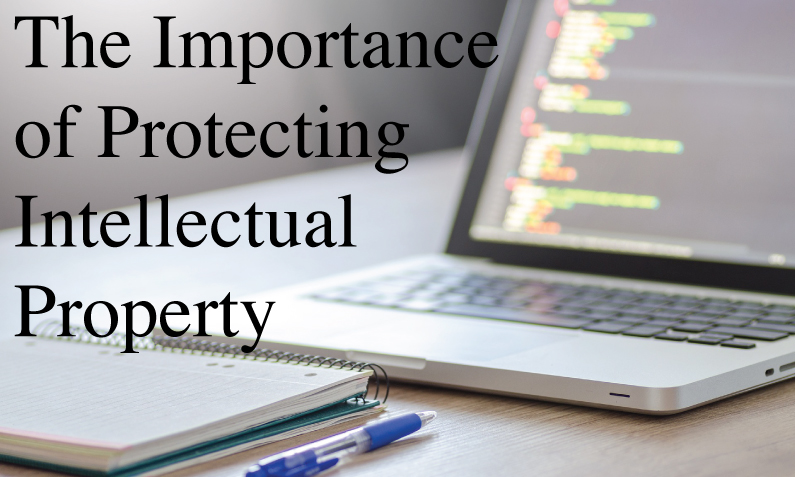 """open laptop and notebook with a pen and caption """"The importance of protecting intellectual property"""""""
